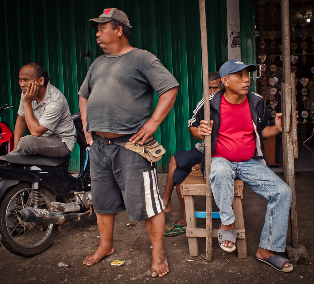 The proud belly owner, his bumbag and his very bored fellowship, Singaraja - Bali